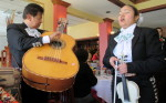 Two mariachi singers